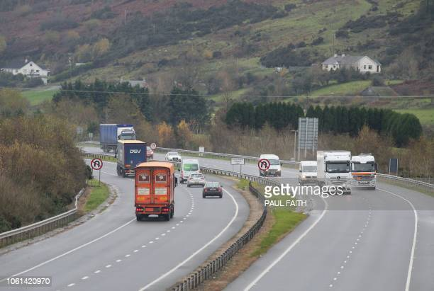 Traffic crosses the border marked by the No UTurn Sign between Northern Ireland and Ireland outside Newry Northern Ireland on November 14 2018 near...