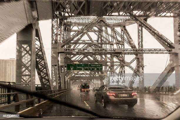 Traffic crosses the Story Bridge in the rain on February 20 2015 in Brisbane Australia Tropical Cyclone Marcia was graded a Category 4 storm as it...