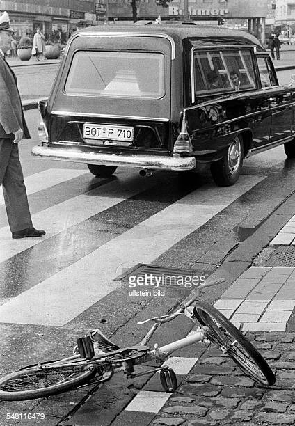 traffic deadly road accident child had been killed childs bicycle lies near a cebra crossing policeman hearse DBottrop Ruhr area North RhineWestphalia