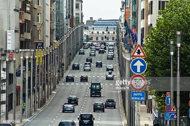 Traffic down Rue De La Loi  in Schuman district, Brussels