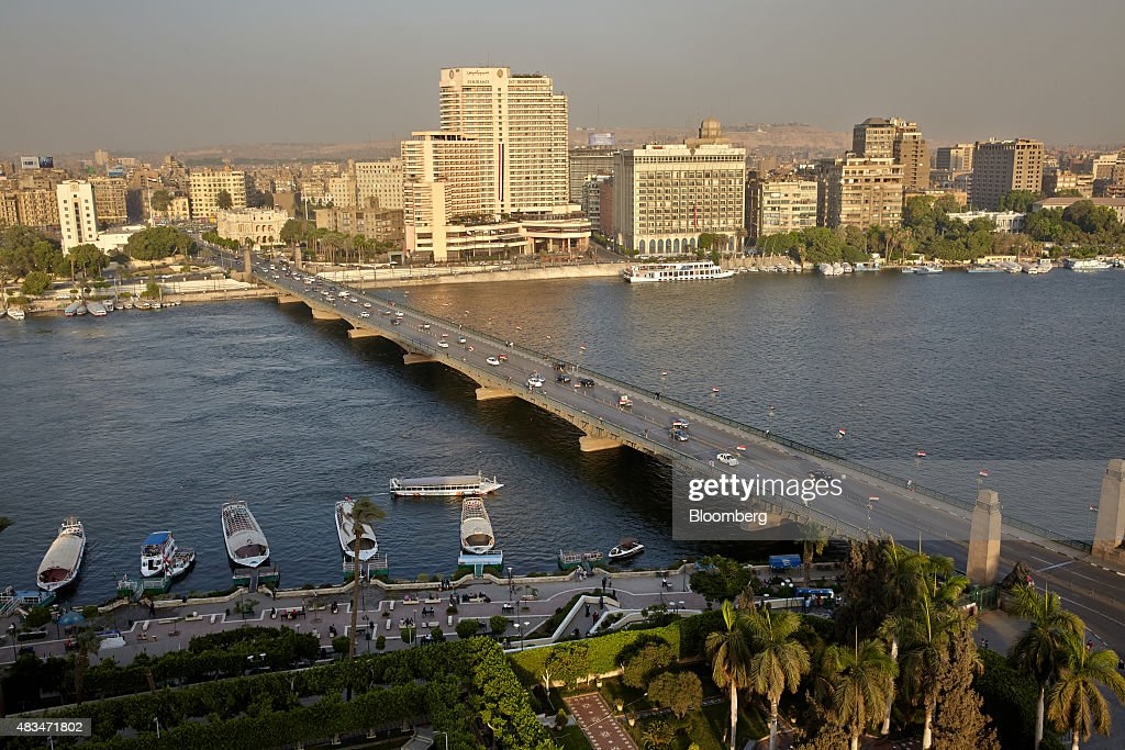 Traffic drives along a bridge spanning the river Nile, in Cairo, Egypt, on Friday, Aug. 7, 2015. The Suez canal extension and other construction projects have boosted the economy, which grew above 4 percent in the nine months to March for the first time since 2010. Photographer: Shawn Baldwin/Bloomberg via Getty Images