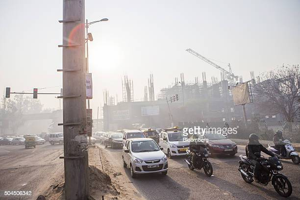 Traffic drives along a road shrouded in smog in New Delhi India on Monday Jan 11 2016 A 2judge Delhi High Court panel headed by Chief Justice G...