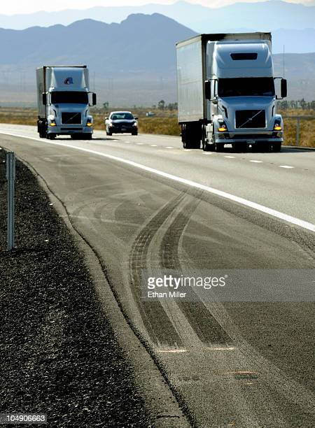 Traffic drives by skid marks from a semitractor trailer on northbound Interstate 15 on October 6 2010 near Mesquite Nevada Steve Lee frontman for the...
