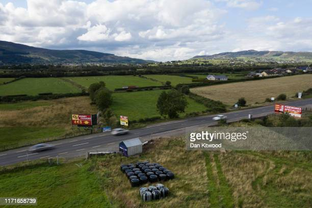 Traffic drives past a former customs guard hut that is situated directly on the border between Northern Ireland and Ireland on August 28 2019 in...