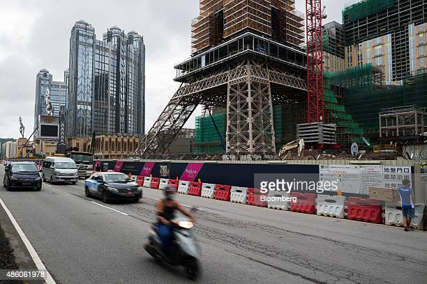 Traffic drives past a halfsized replica of the Eiffel Tower stands at the construction site of Parisian Macao operated by Sands China Ltd a unit of...
