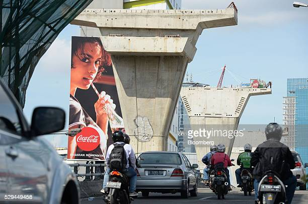Traffic drives past a highway under construction in Jakarta Indonesia on Wednesday May 4 2016 Indonesia's economy grew less than analysts expected in...