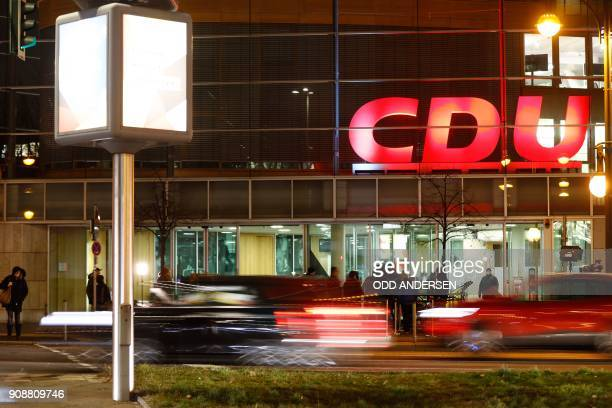 Traffic drives past the CDU headquarters where journalists wait ahead of coalition talks between the leaders of the CDU CSU and SPD in Berlin on...