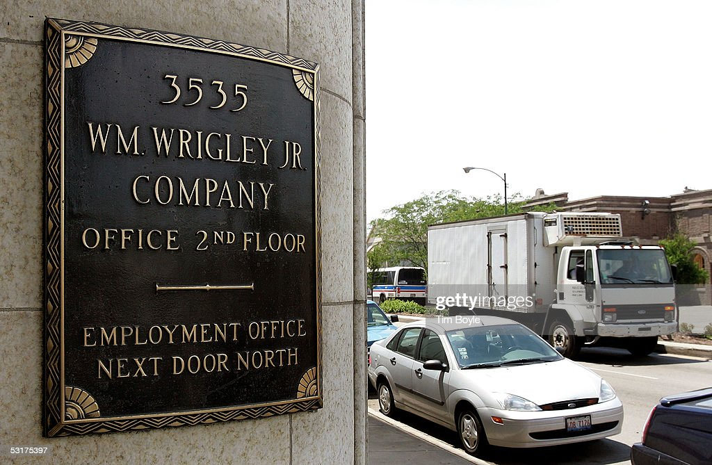 Traffic drives past the front entrance of the Wm. Wrigley Jr. building June 30, 2005 in Chicago, Illinois. Chicago-based Wm. Wrigley Jr. has said on June 29 it will close the 94-year-old factory that produces the company's chewing gum, effecting close to 600 workers, after its acquisition of Kraft Foods' Life Savers and Altoids brands.