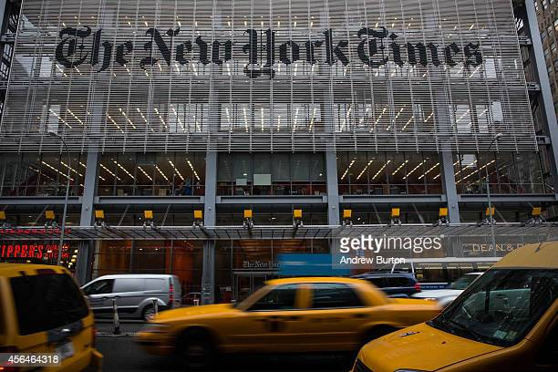 Traffic drives past The New York Times building on October 1 2014 in New York City The Times announced plans to cut approximately 100 jobs from the...