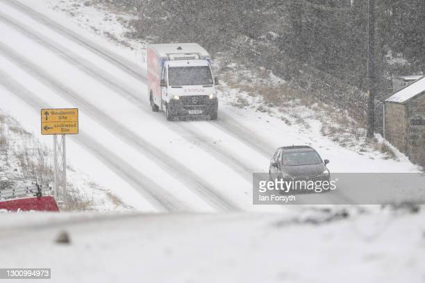 Traffic drives through heavy snow between Guisborough and Whitby on February 08, 2021 in Guisborough, United Kingdom. Heavy snow in Scotland and...