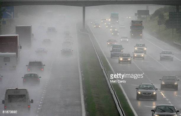 Traffic drives through rain and spray on the M5 motorway on July 9 2008 near WestonSuperMare England Weather forecasts have suggested that the UK is...