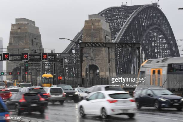 Traffic during the morning commute drives in rain on the Harbour Bridge on October 4 2018 in Sydney Australia Sydney is expected to have its wettest...
