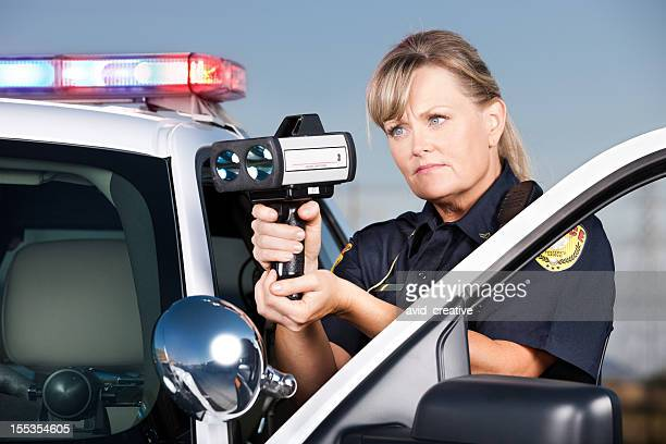 Traffic Enforcement: Woman Police Officer with Laser Gun