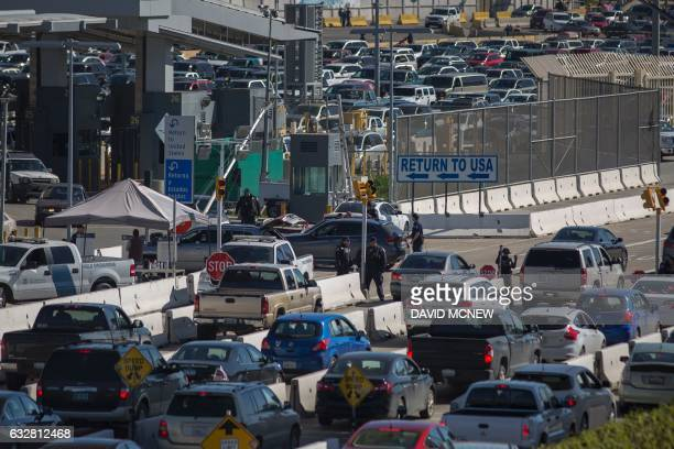 Traffic enters Mexico in the foreground and into the United States in the distance near a massive construction project to revamp federal facilities...