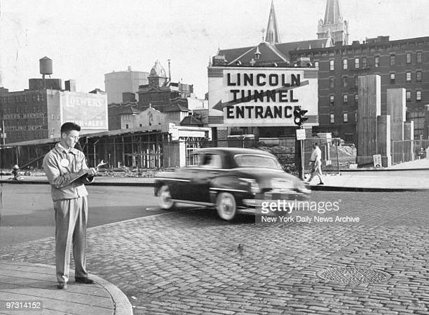 Traffic enumerator Patrick Munnelly checks cars going into the Lincoln Tunnel