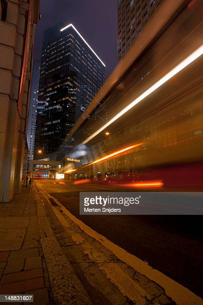 traffic flashing by during the evening with high-rise surrounding. - merten snijders stock pictures, royalty-free photos & images