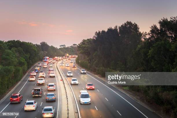 traffic flow - multiple lane highway stock pictures, royalty-free photos & images