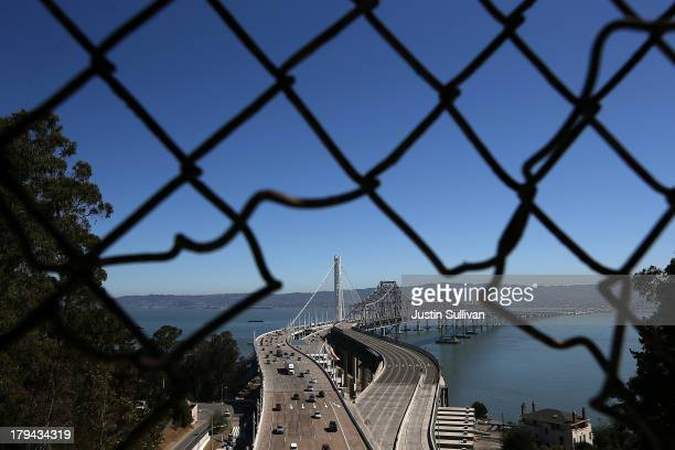 Traffic flows across the new eastern span of the San Francisco Oakland Bay Bridge as the old eastern span sits empty on the morning after the...