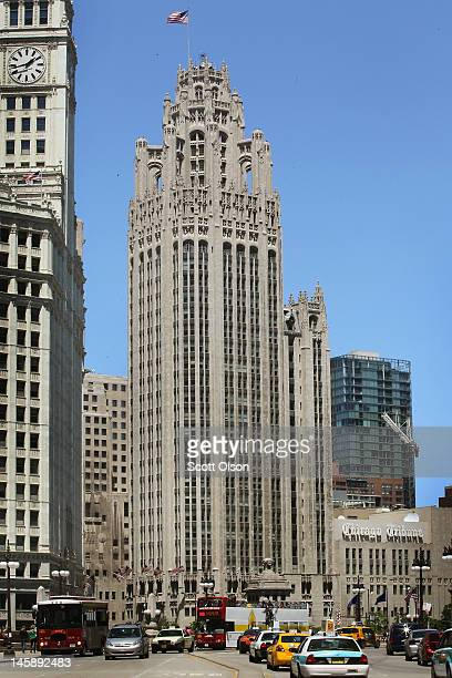 Traffic flows along Wacker Drive near the Tribune Tower headquarters of the Tribune Company on June 7 2012 in Chicago Illinois The Tribune Company...
