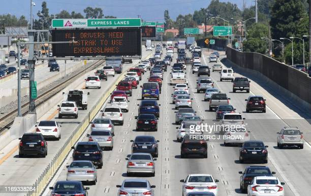 Traffic flows east on the Interstate 10 freeway down FasTrak express lanes and regular lanes in Los Angeles on September 18 2019 President Donald...