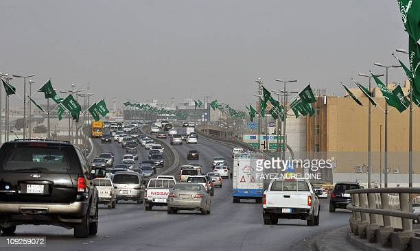 Traffic flows on February 18 2011 on a main highway in the Saudi capital Riyadh decorated with national flags on the eve of King Abdullah bin Abdul...