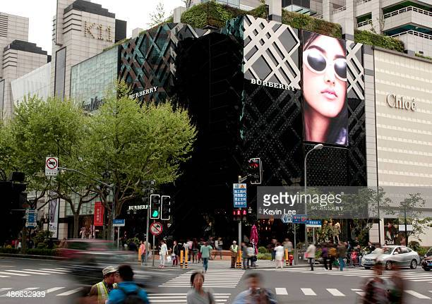 Traffic flows past the front of Burberry's new flagship store on April 25 2014 in Shanghai China
