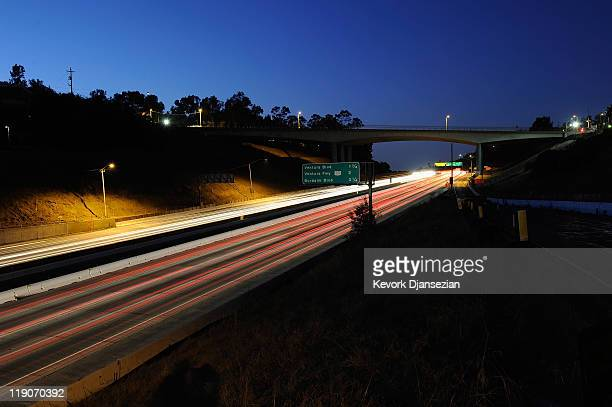 Traffic flows under the Mulholland Bridge on Interstate 405 one day before it is slated to be demolished during the 11mile shutdown of Interstate 405...