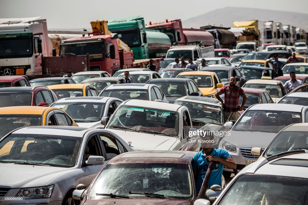 Traffic from Mosul queues at a Kurdish Check point on June 14, 2014 in Kalak, Iraq. Thousands of people have fled Iraq's second city of Mosul after it was overrun by ISIS (Islamic State of Iraq and Syria) militants. Many have been temporarily housed at various IDP (internally displaced persons) camps around the region including the area close to Erbil, as they hope to enter the safety of the nearby Kurdish region.
