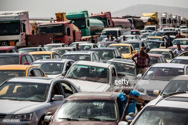 Traffic from Mosul queues at a Kurdish Check point on June 14, 2014 in Kalak, Iraq. Thousands of people have fled Iraq's second city of Mosul after...