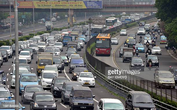 Traffic grindes to a slow pace during the morning rush in Jakarta on December 11 2012 In 2014 according to the private Indonesian Transportation...