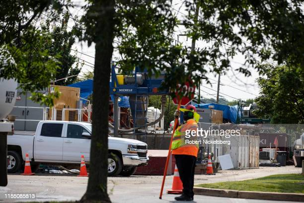 Traffic guard stands near a horizontal boring device for the ETP-Sunoco Mariner East 2 pipeline in West Chester, Pennsylvania on June 5, 2019. Once...