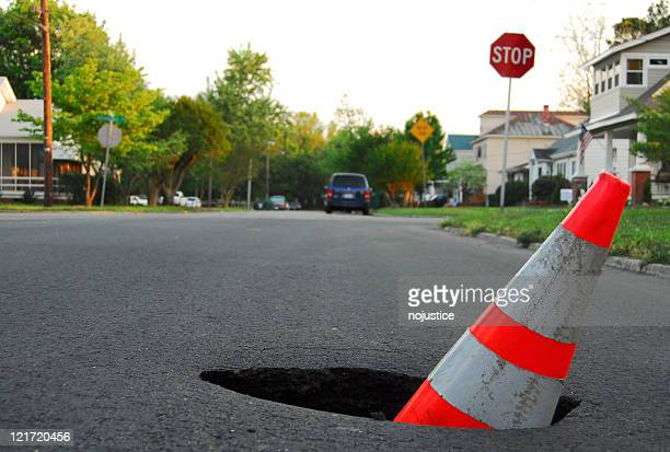 traffic hazard - sinkhole stock photos and pictures