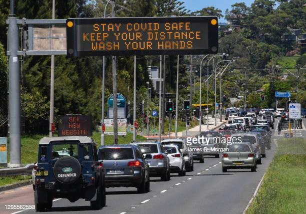 Traffic heading towards the city are warned about Covid-19 on digital displays at North Narrabeen on January 10, 2021 in Sydney, Australia. From...