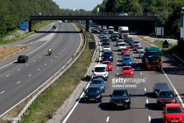 Traffic heads westward along the M3 near Eastleigh Hampshire on May 30 as lockdown measures are eased during the novel coronavirus COVID19 pandemic...