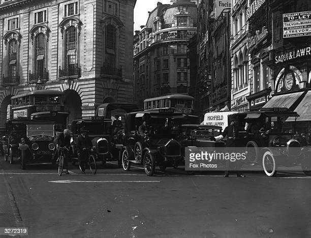 Traffic heldup by a policeman in Piccadilly London