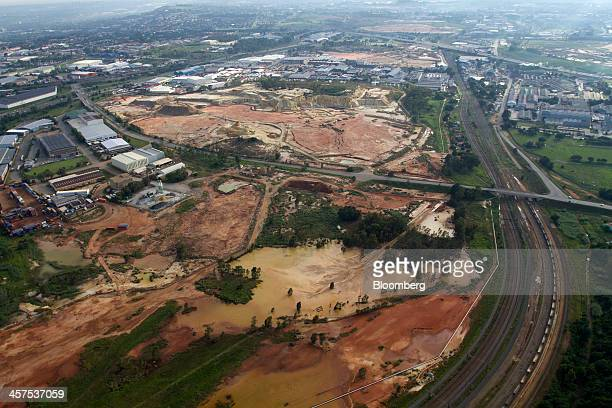 Traffic highway and railway lines, right, pass waste ground and a mine dump in this aerial view of Johannesburg, South Africa, on Saturday, Dec. 14,...