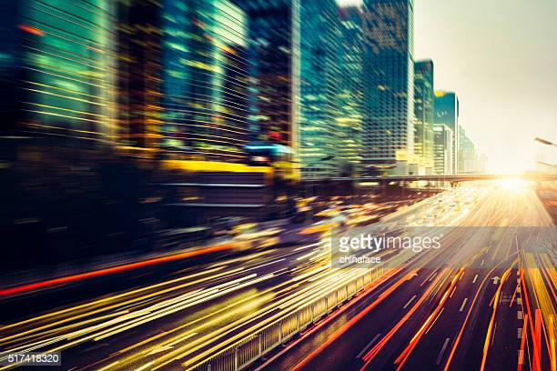 traffic in beijing at night - motion blur stock photos and pictures