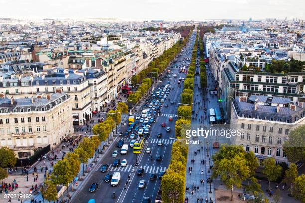 traffic in champ elysees street - avenue stock pictures, royalty-free photos & images