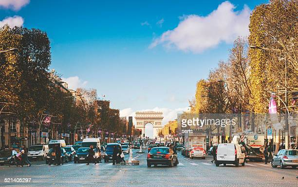 traffic in champs elysees street - champs elysees quarter stock pictures, royalty-free photos & images