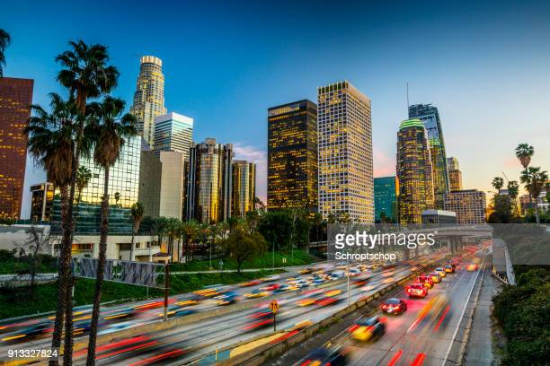 traffic in downtown los angeles, california - skyline stock pictures, royalty-free photos & images