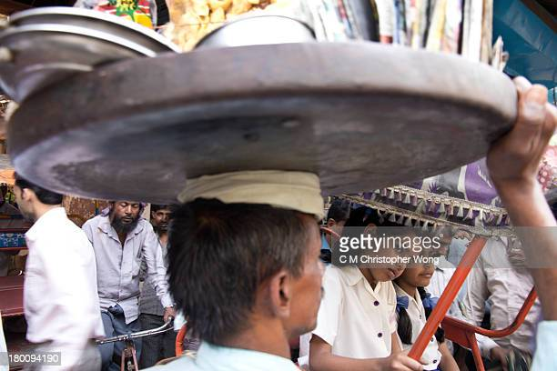 Traffic in India is normally dangerous, but not in the hectic Old Delhi, because nothing can move fast. After school, school girls, good vendor,...