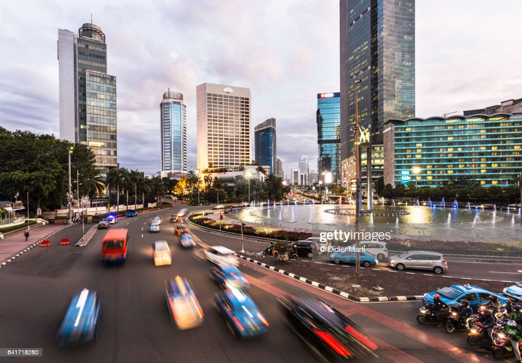 Traffic in Jakarta modern business district at sunset in Indonesia : Stock Photo