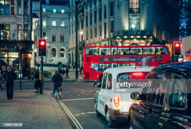 traffic in london - shaftesbury avenue london stock photos and pictures