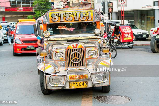 traffic in manila, philippines - jeepney stock pictures, royalty-free photos & images