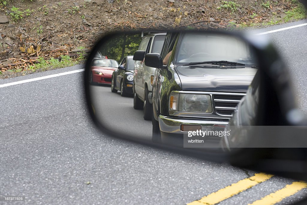 Traffic in the rear view mirror : Stock Photo