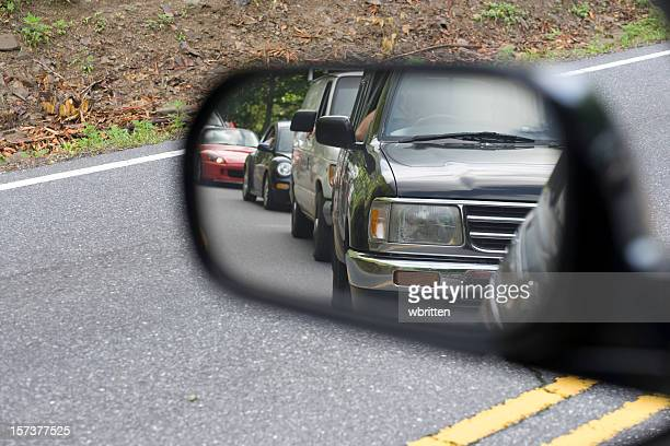 traffic in the rear view mirror - following stock pictures, royalty-free photos & images