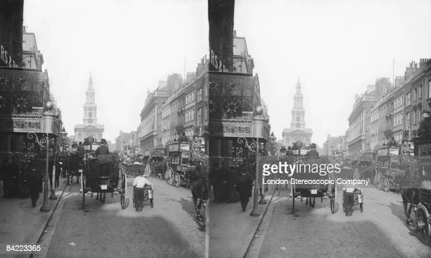 Traffic in the Strand London with the church of St MaryleStrand in the background circa 1900
