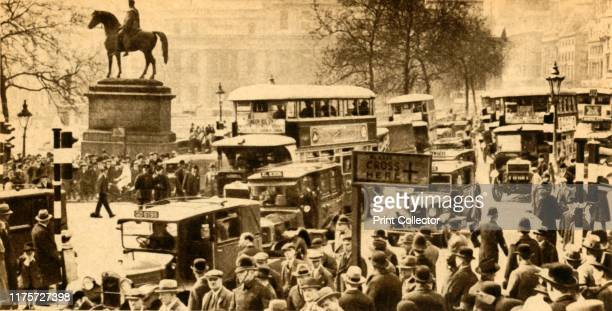 Traffic in Trafalgar Square London 1933 Buses taxis and pedestrians with the equestrian statue of King George IV on the left 'Trafalgar Square's...