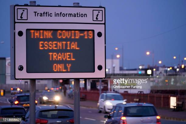 A traffic information sign declares 'essential travel only' as people begin to adhere to government advice on social distancing on March 19 2020 in...
