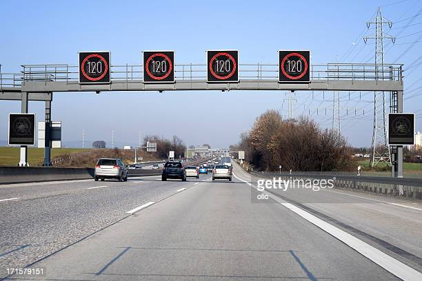 traffic information system on highway- speed limit - speed limit sign stock photos and pictures